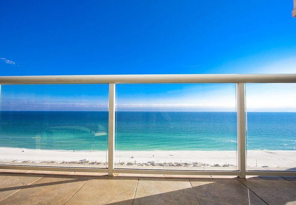 sky water Beach Ocean shore Sea property horizon Coast caribbean walkway wave sand Island