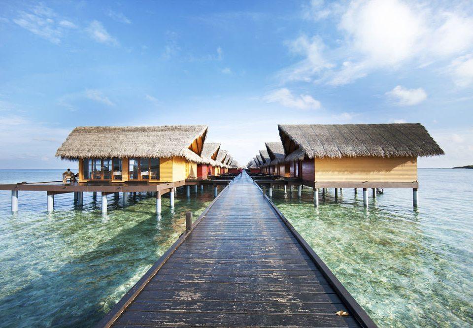 sky water pier wooden house Sea shore Beach Ocean Coast Resort Island boathouse