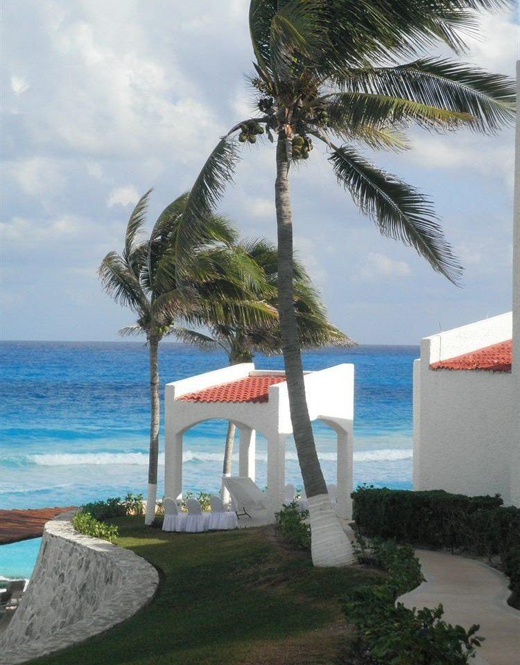 tree water sky Beach plant caribbean Ocean Sea palm Coast arecales palm family Resort Island tropics cape Villa shore overlooking