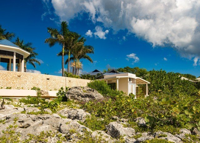 sky property building Coast rock Sea caribbean Ocean house Resort Beach Villa Village cape Island stone