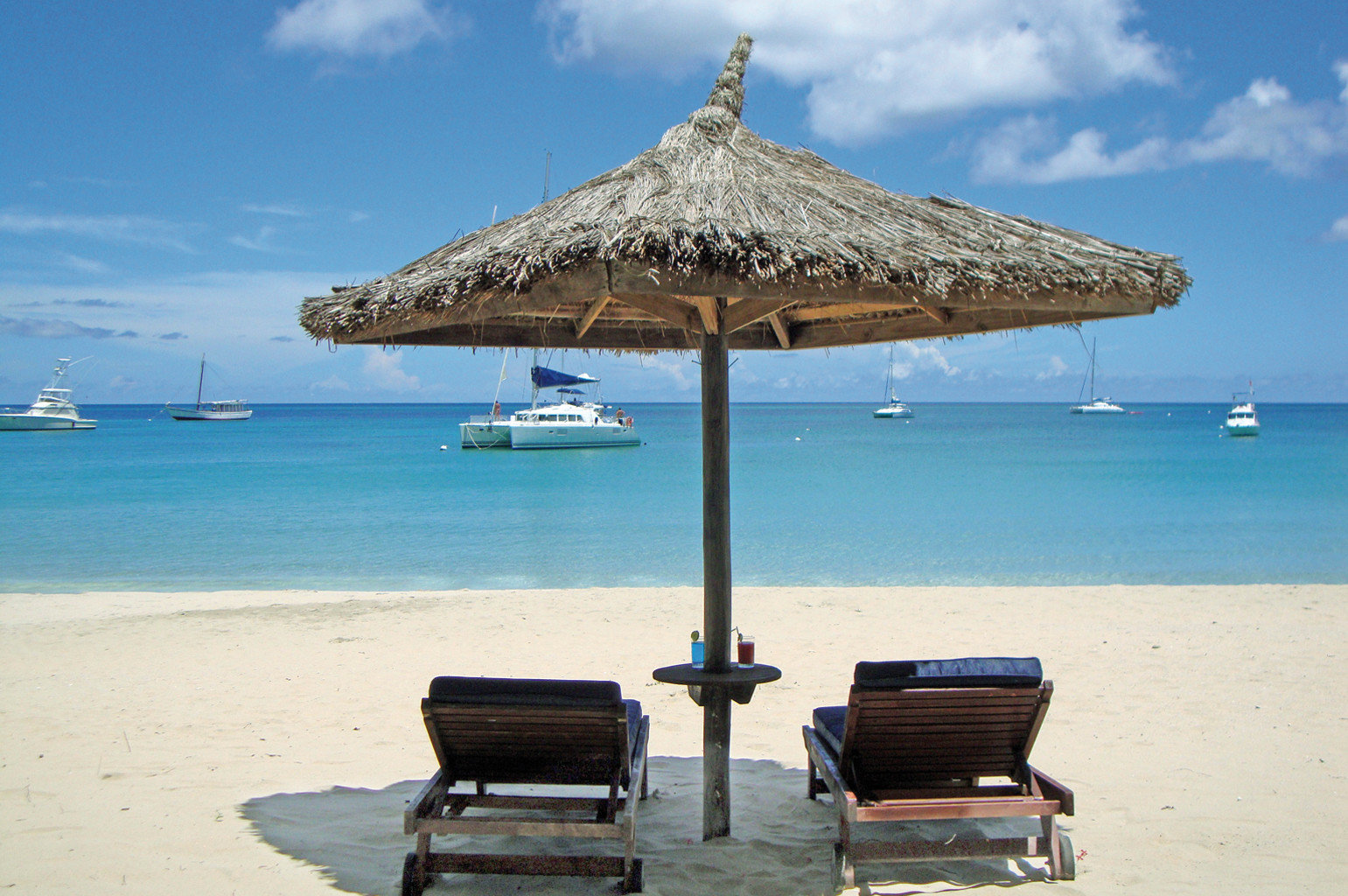 sky water chair umbrella Beach Sea Ocean shore Coast caribbean Island lawn cape pier vehicle travel empty day