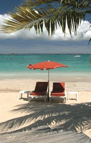 water Beach sky umbrella chair shore caribbean Sea Ocean Nature Coast Resort sand Lagoon wind sailing vessel sandy