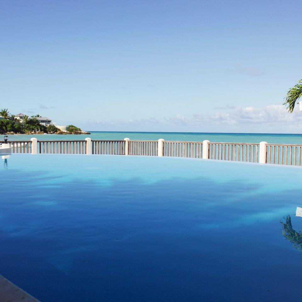 sky water tree swimming pool Nature property Resort Sea Ocean Beach Lagoon resort town marina shore Coast condominium Villa Pool caribbean blue lined swimming