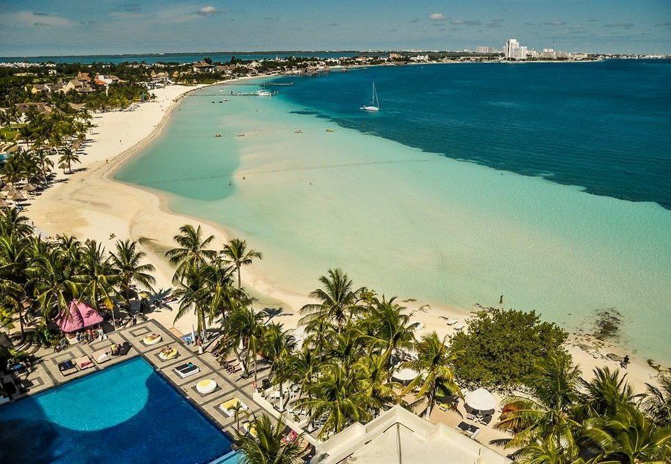 water sky Nature Beach Sea caribbean Ocean Coast Resort shore Lagoon swimming pool reef cape tropics cove lined swimming sandy