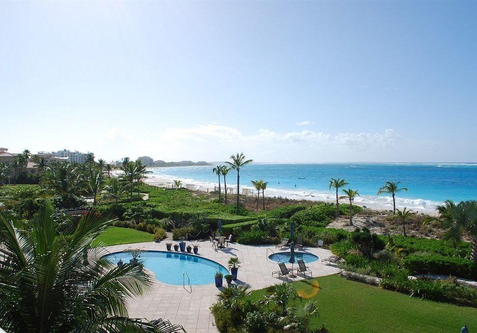 sky grass property Beach Resort Nature Sea Ocean caribbean Coast swimming pool Lagoon cape tree shore palm plant lined
