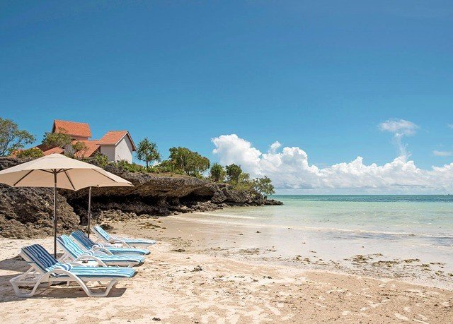 sky Beach ground umbrella shore Sea Coast Ocean Nature caribbean Lagoon sand cape Resort cove sandy day