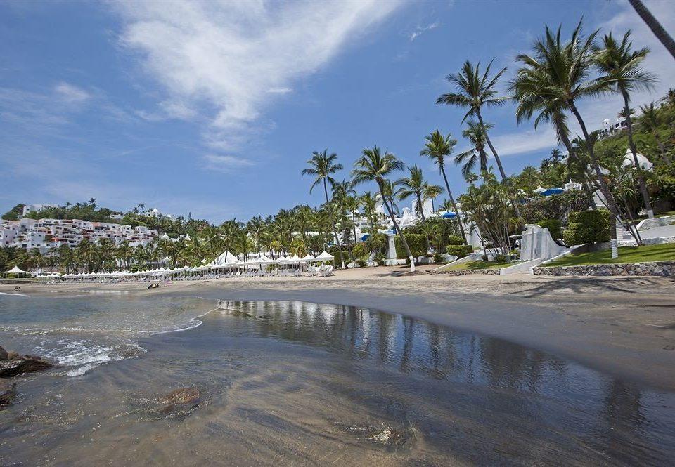 sky Beach water shore Nature Sea Coast tree Ocean palm arecales Resort Lagoon tropics cove sandy day