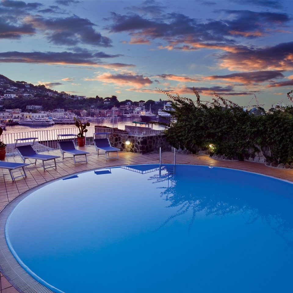 sky water swimming pool Sea Ocean Coast Resort Beach Lagoon dusk overlooking