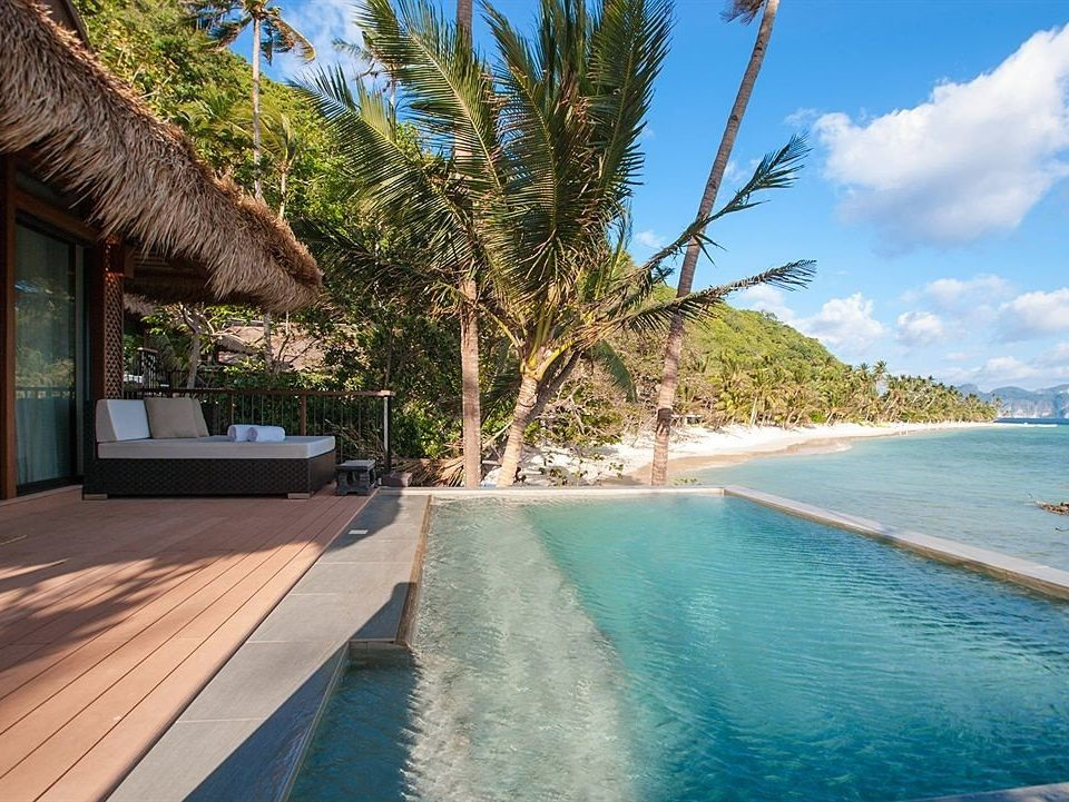 sky tree swimming pool property caribbean Beach Resort Sea Ocean arecales Lagoon tropics Coast Villa palm plant shore