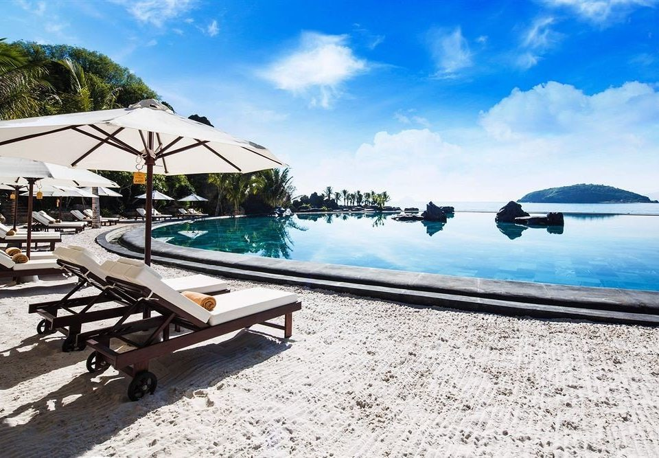 sky ground leisure Beach Sea shore swimming pool Resort Ocean Coast Lagoon dock marina caribbean sandy day