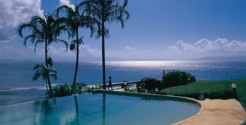 sky water property leisure Resort swimming pool caribbean Ocean Sea Lagoon Villa Coast Beach condominium reef shore overlooking