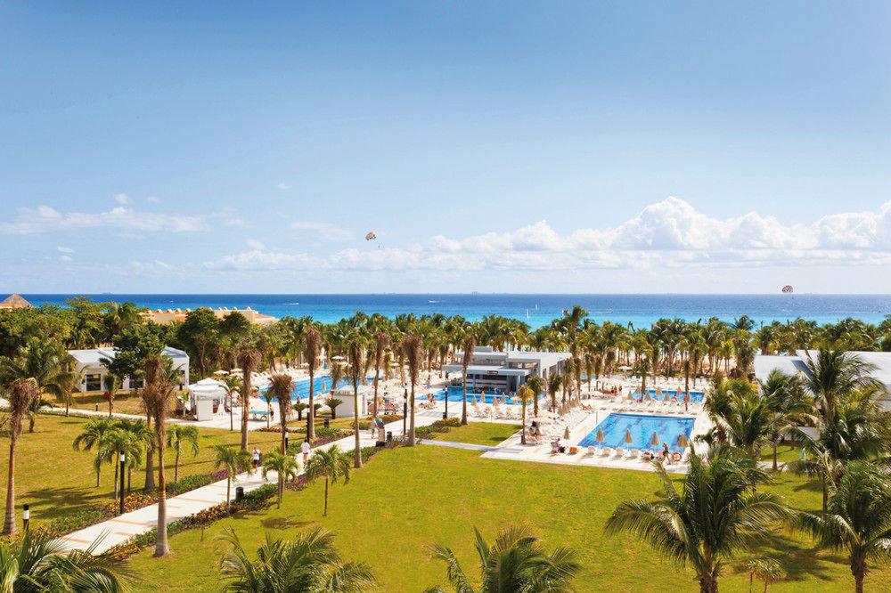 sky grass Beach Resort walkway caribbean Sea Coast marina Lagoon boardwalk plant shore lush day
