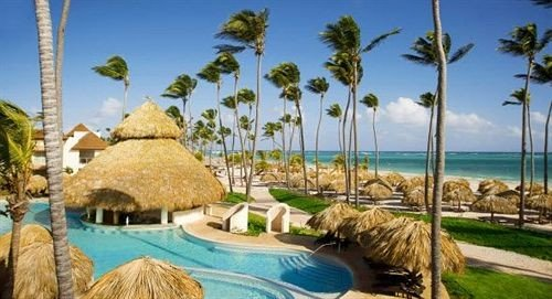 tree sky grass property leisure Resort caribbean Beach swimming pool Coast arecales Villa Lagoon palm plant shore