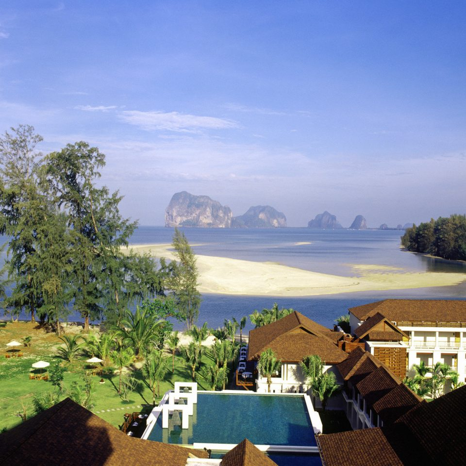 Mountains Patio Pool Scenic views sky Sea Ocean Coast landscape Lake Resort Beach overlooking lush