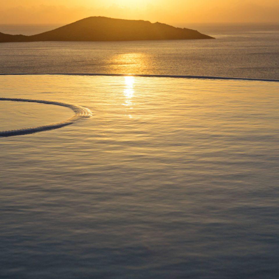 water sky Nature Sea horizon Beach shore Sunset sunrise Ocean dawn Coast morning cloud wave dusk sunlight Sun afterglow evening Lake wind wave loch