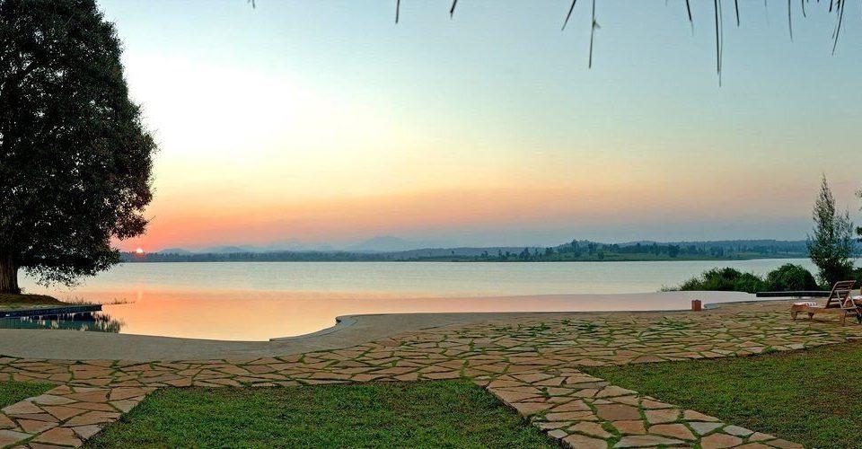 sky grass water horizon shore Ocean Sea Nature morning Coast Beach Sunset sunlight Lake dusk overlooking