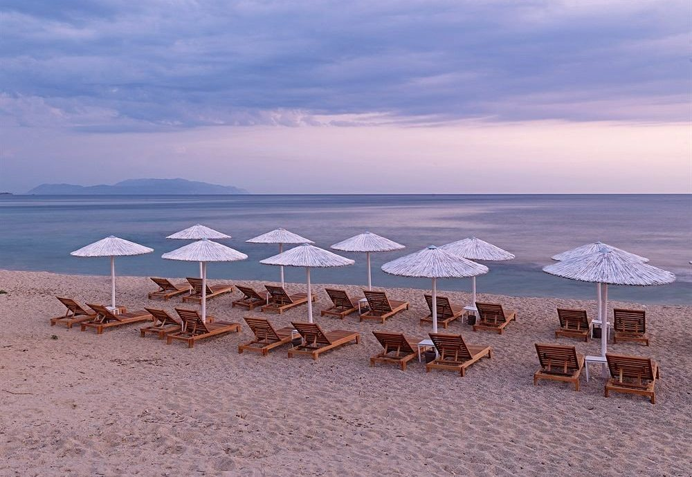 umbrella sky water Beach ground chair shore Sea Ocean horizon lawn natural environment Coast Lake morning Nature sand lined set cape dusk sandy line shade