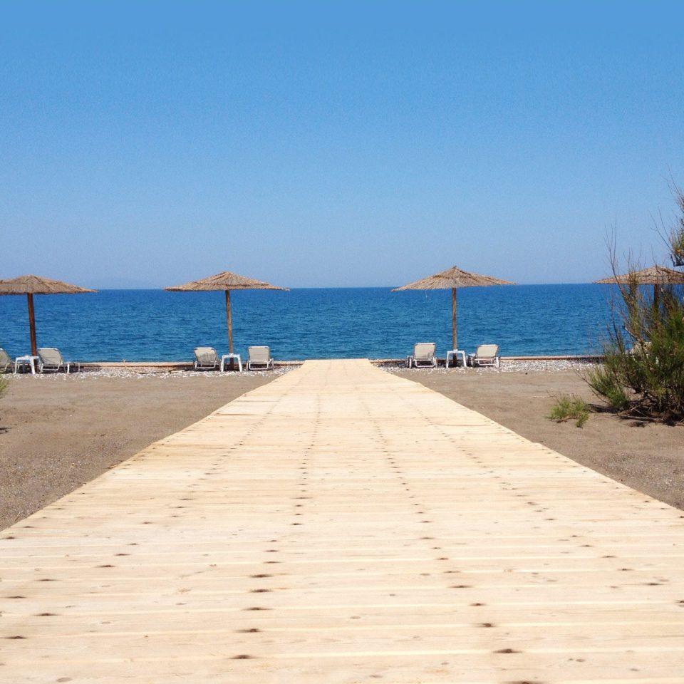Lounge Outdoors Resort Scenic views sky ground water Beach walkway shore Sea boardwalk Coast sand swimming pool sandy