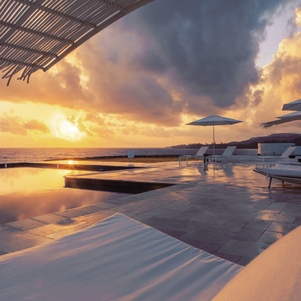 Luxury Pool Romance Romantic Scenic views Tropical Waterfront sky plane Sunset sunrise cloud Sea horizon Ocean shore dawn morning Beach evening dusk sunlight wave Coast sand meteorological phenomenon Sun clouds