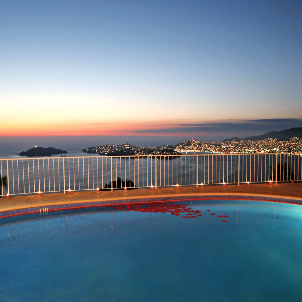 Luxury Pool Waterfront sky water pier horizon swimming pool scene Sea Beach Ocean dusk evening Sunset Coast sandy