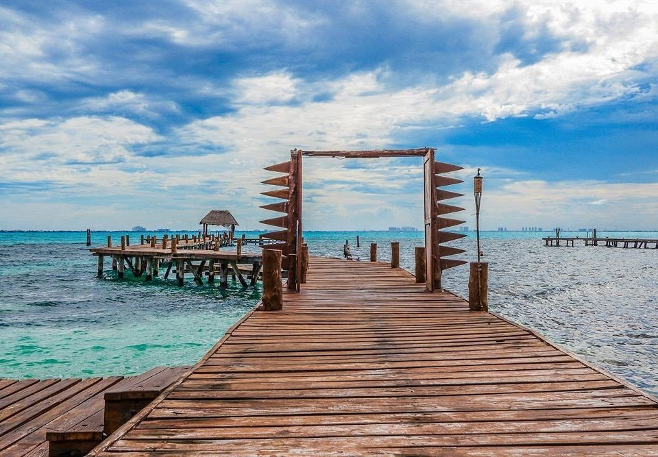 Modern Ocean Tropical Waterfront sky ground pier water chair wooden scene shore Sea walkway Beach horizon boardwalk dock Coast sandy day