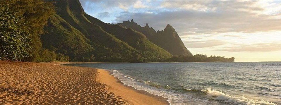 Beach Mountains Ocean Resort sky Nature water mountain Coast shore cliff Sea terrain cape sandy