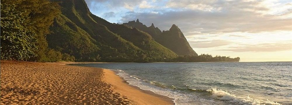 Beach Mountains Ocean Resort sky Nature water mountain Coast shore cliff Sea terrain cape sandy