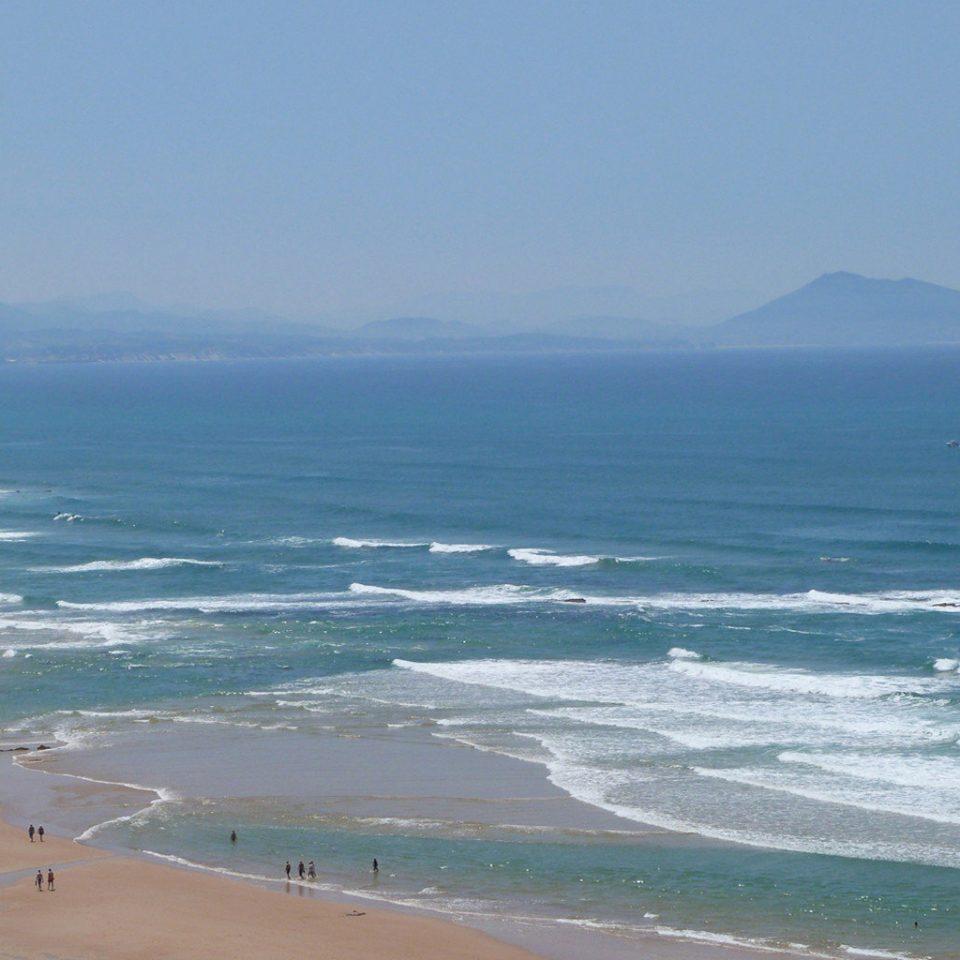 water sky Nature Beach Sea mountain Ocean Coast shore horizon wind wave wave cape sand terrain sandy day