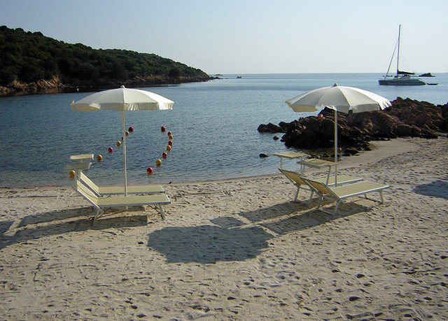 water sky umbrella Beach Nature shore Sea chair Coast Ocean sand cape cove vehicle lawn set day line sandy