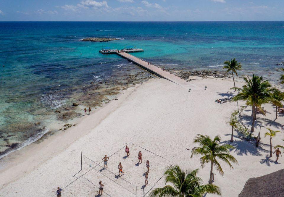water sky Beach Nature shore Coast Sea Ocean caribbean sand cape terrain cove palm lined sandy