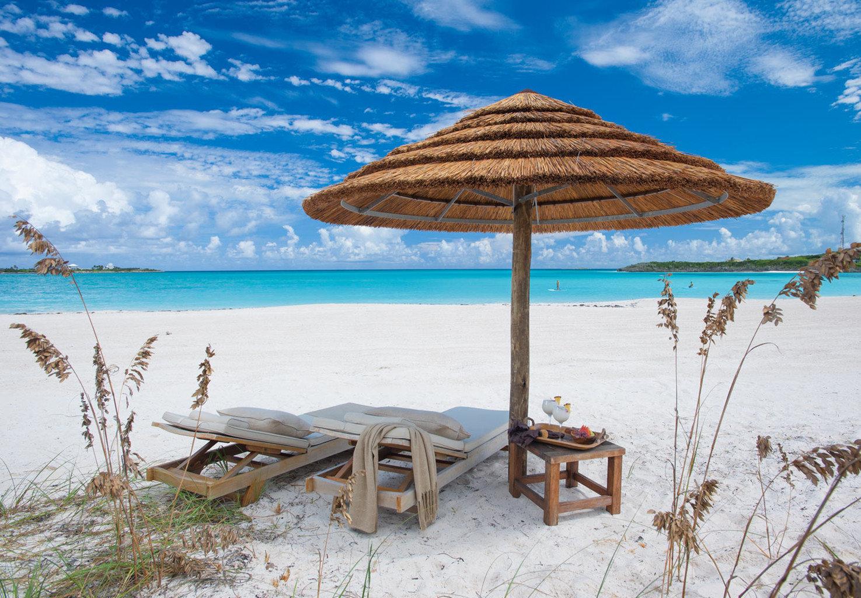 umbrella sky water Beach chair shore Sea Ocean lawn Coast Nature Resort caribbean sand set