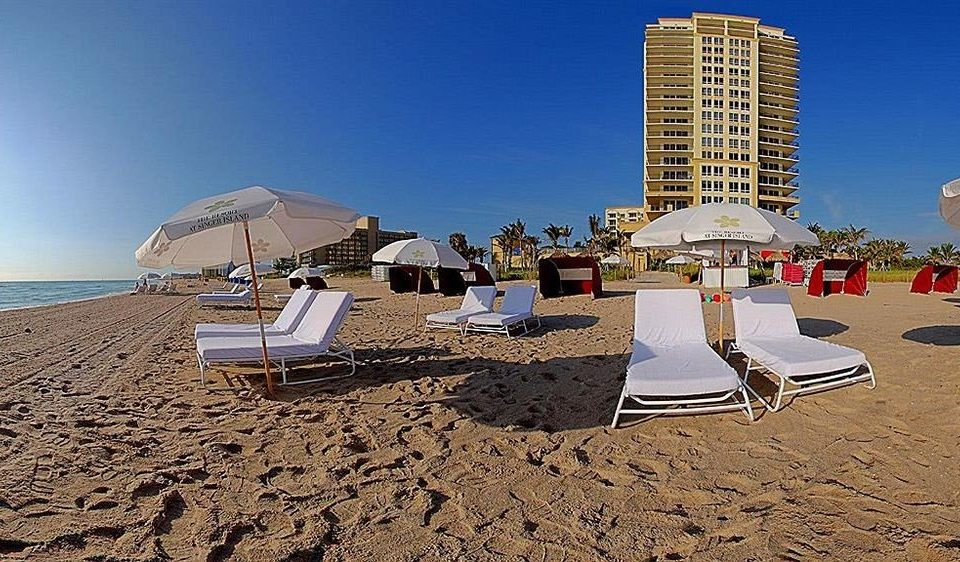 sky Beach chair Sea Nature Coast Ocean Resort sand walkway tower shore sandy day