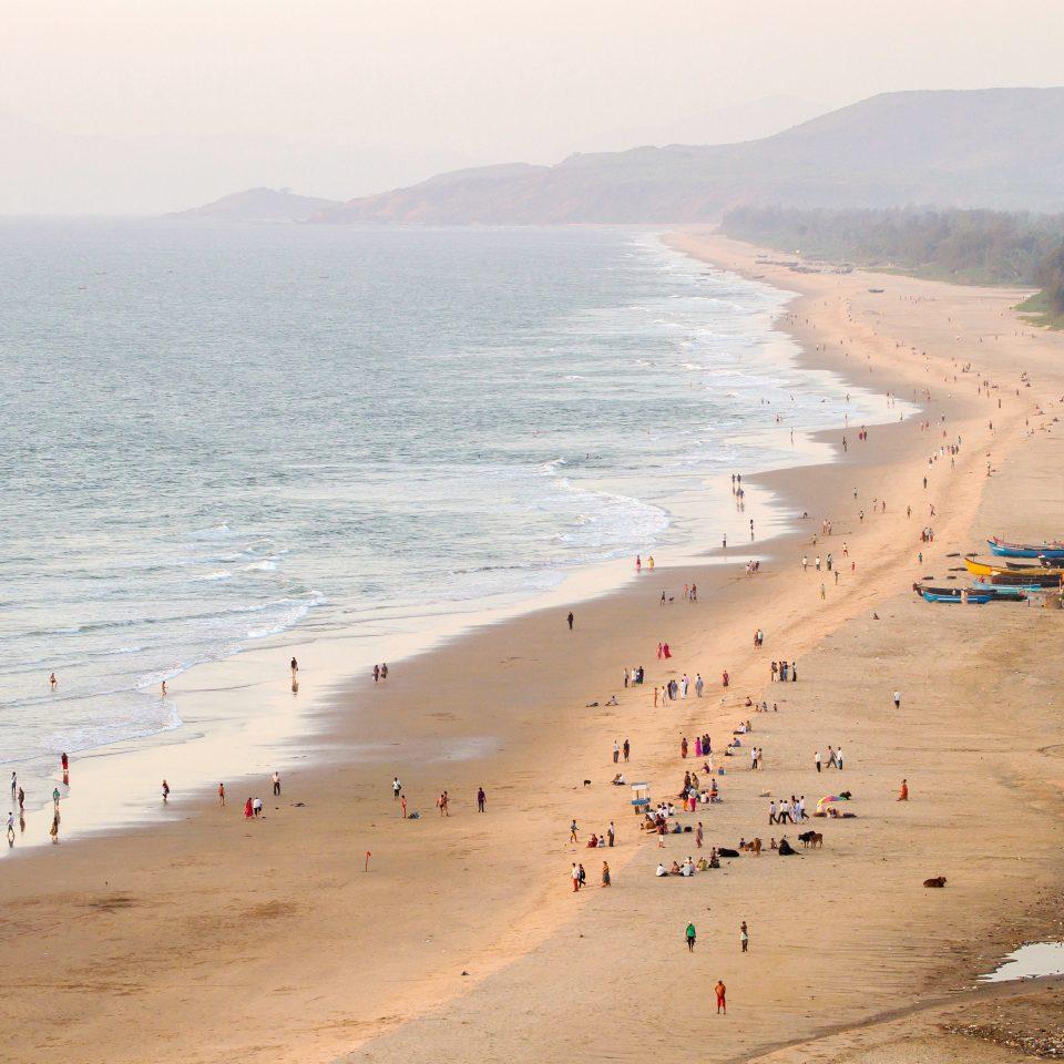 Beach sky Nature water ground shore Coast Sea Ocean sand wind wave wave sandy cape material dune day