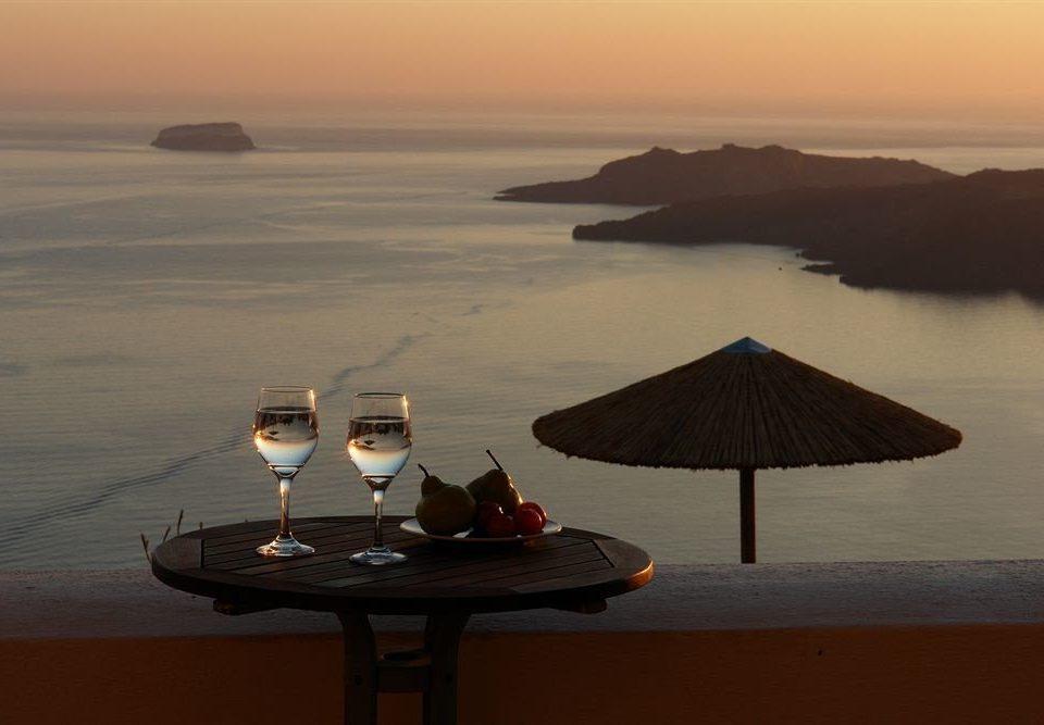 water sky umbrella chair Beach sunrise Sunset Sea horizon Ocean dawn Nature evening morning shore dusk Coast overlooking