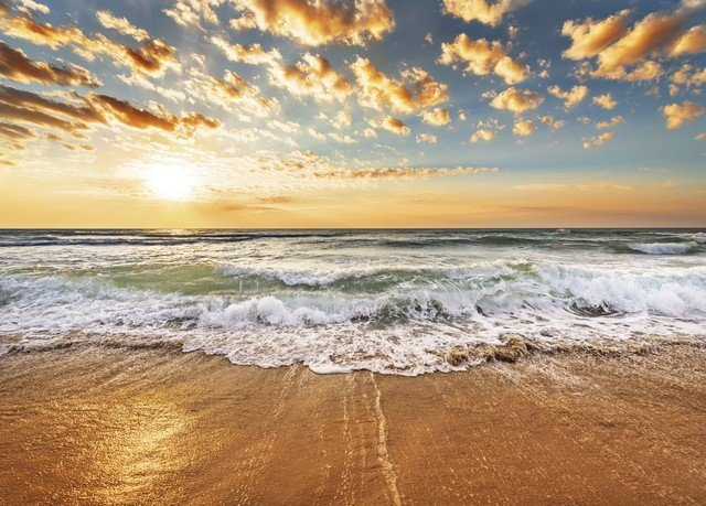 Beach water sky shore Sea wave Ocean horizon Coast wind wave cloud Nature sunrise sand morning Sunset sunlight dawn Sun dusk material sandy
