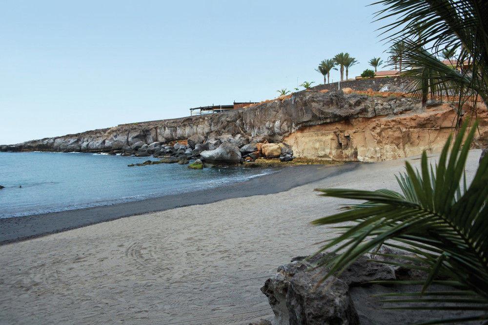 sky shore Beach Coast Sea Nature Ocean arecales rock cliff terrain cove cape walkway tree plant sandy