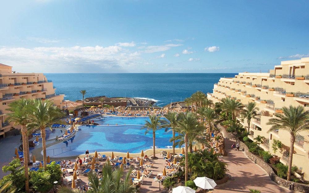 sky umbrella Resort property leisure Nature Sea Beach Coast swimming pool caribbean Ocean cape palm overlooking shore lined day