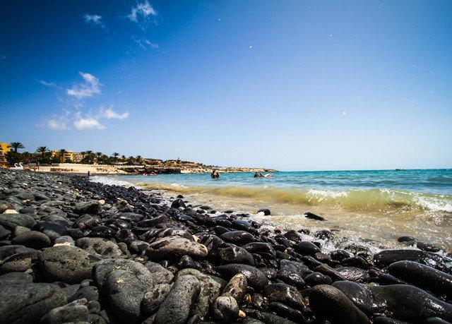 sky rock Beach shore Sea Coast Ocean wave horizon wind wave rocky Nature cove sand cape material sandy