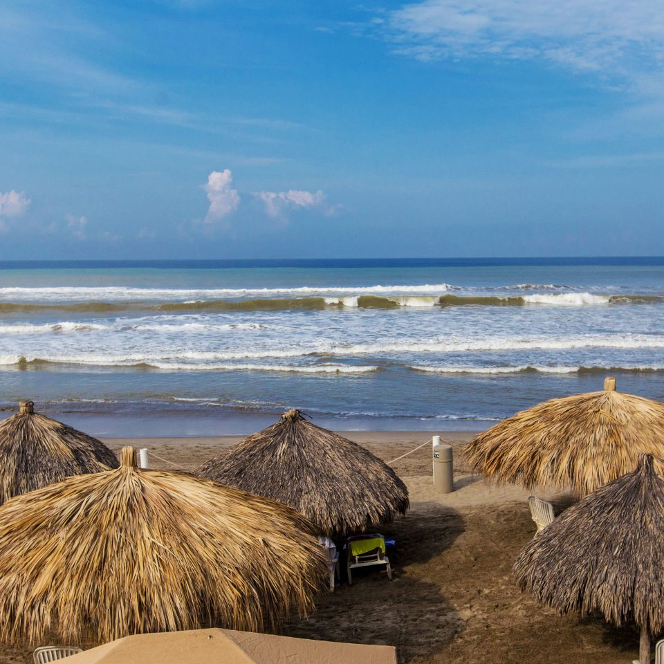 sky water Beach shore Sea Coast Ocean horizon sand Nature rock cape material sandy outdoor object