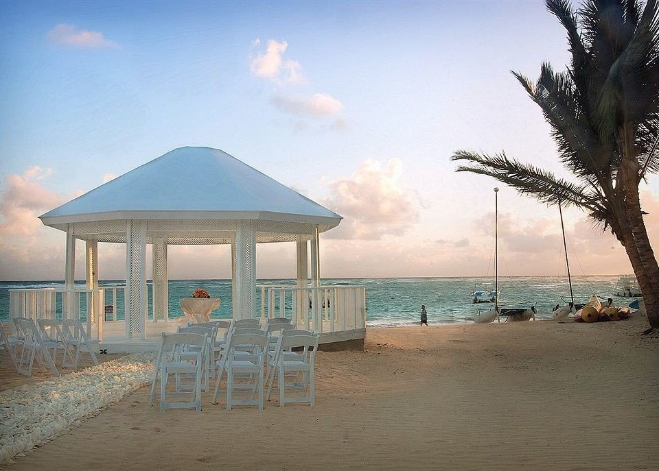 sky Beach ground umbrella Sea Ocean shore Nature arecales Resort walkway Coast caribbean sandy shade day