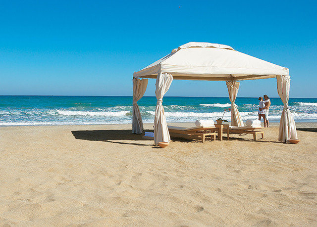 sky Beach chair ground umbrella water leisure shore Ocean Sea lawn caribbean sand Coast Nature walkway Resort sandy lined