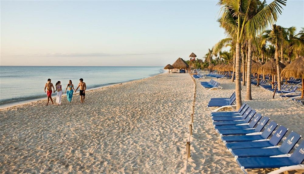 sky Beach water ground shore Nature walkway Sea Coast boardwalk Ocean sand sandy cape Resort pier palm line day