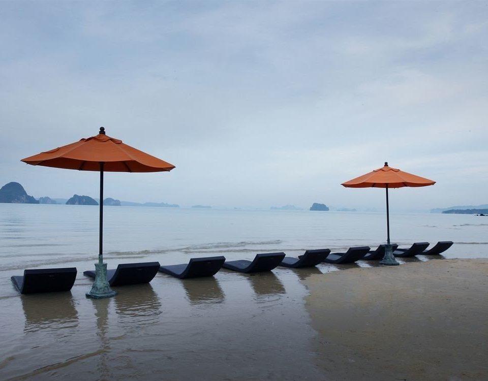 water sky umbrella Beach Sea chair shore Ocean Nature Coast wind line lined sandy day