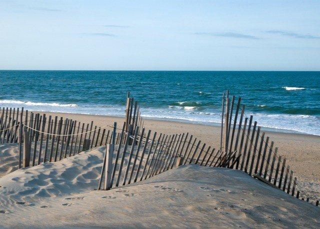 sky water ground Beach chair Ocean shore Sea Coast sand horizon Nature wind wave breakwater wave pier cape lined sandy material line
