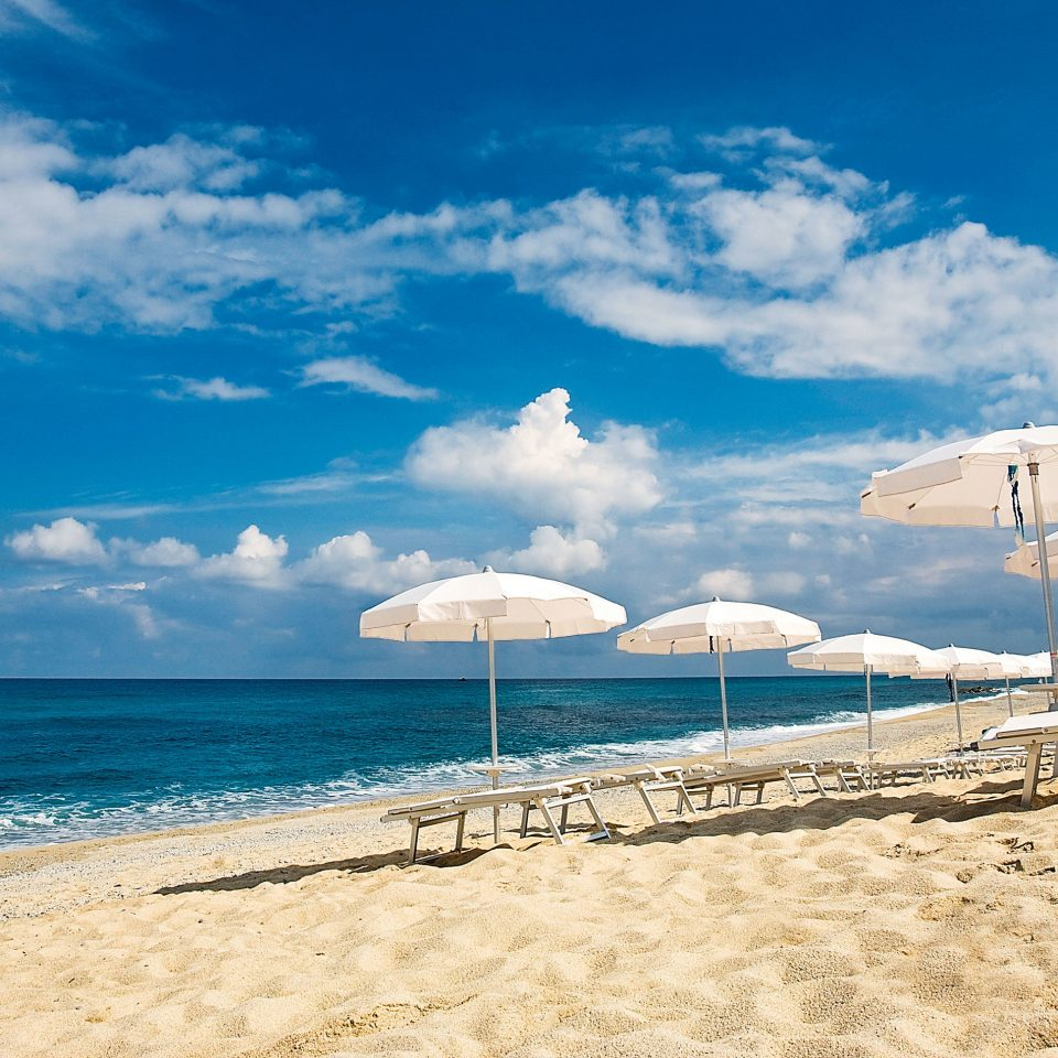 sky Beach umbrella water Sea shore Ocean cloud horizon Nature Coast caribbean cape sand wave blue sandy day