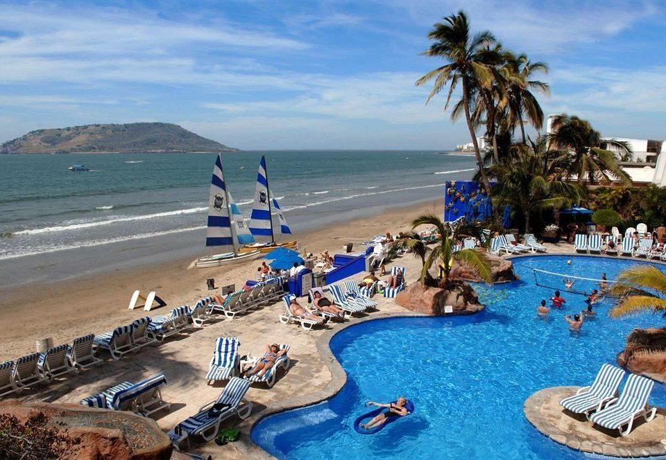 water Beach sky leisure Ocean Resort Sea Nature swimming pool Water park Coast shore swimming lined sandy