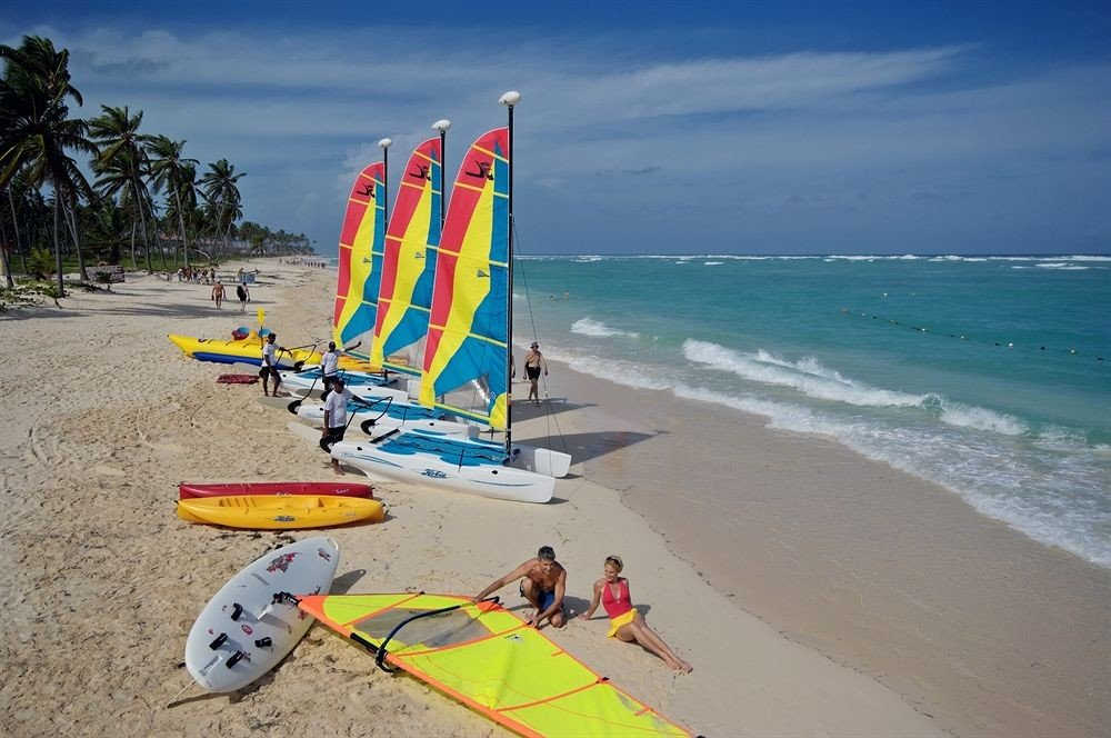 sky Beach ground windsurfing sailing Sea Nature surfing vehicle sports Ocean surfboard wind toy surfing equipment and supplies shore Coast sand boardsport water sport surface water sports sandy