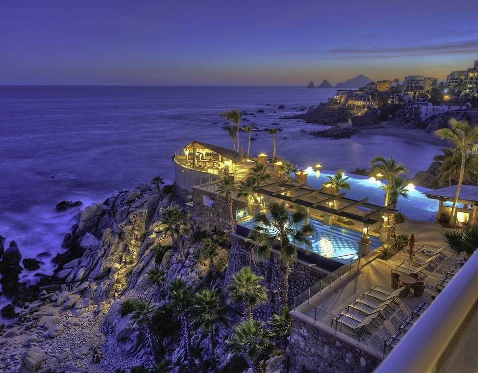 sky water Coast Sea landmark Ocean horizon night Nature tower evening dusk cape Beach terrain Resort