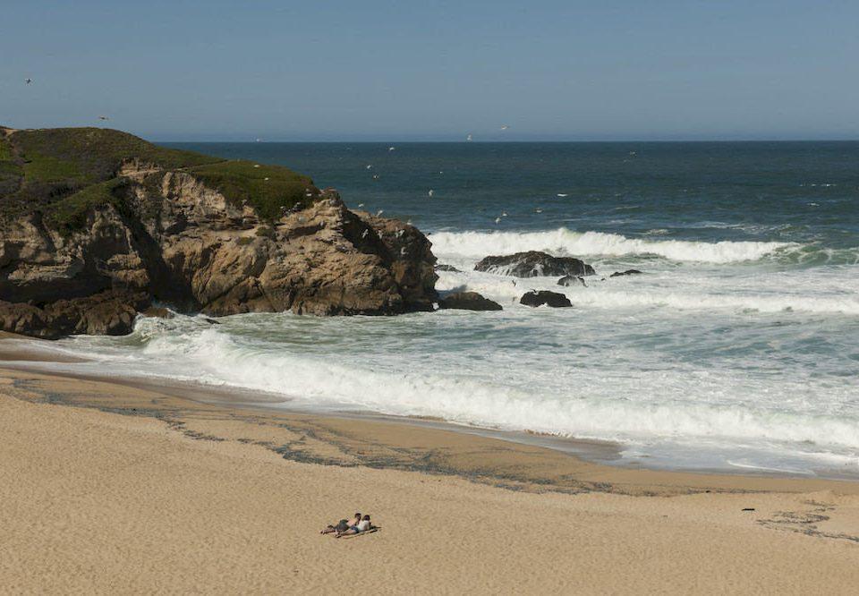 sky water Beach Nature Coast shore Sea Ocean headland wave wind wave horizon sand rock cliff cape terrain cove material sandy