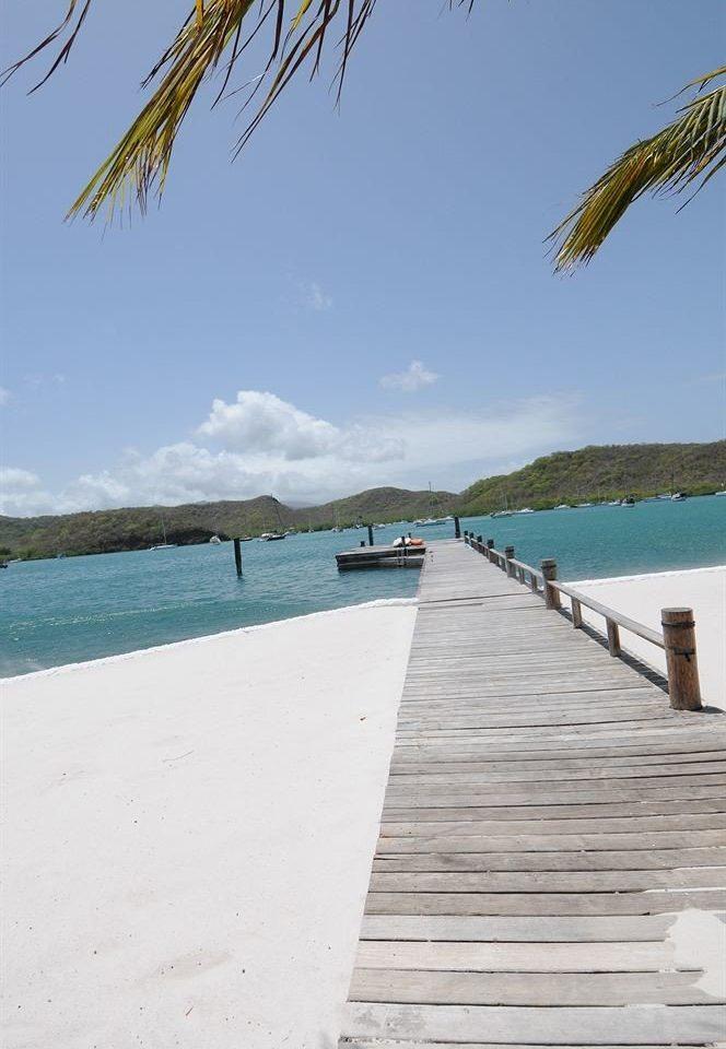 Beach Scenic views Tropical sky water shore Sea walkway Ocean Coast boardwalk Nature sand caribbean dock lined day sandy